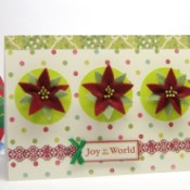 card with 3 felt poinsettias