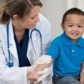 A child being seen by a doctor.