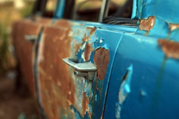 Rust and Peeling Blue Paint on Car