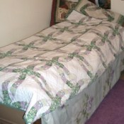 Wedding ring quilt pattern bedspread.