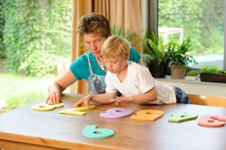 Boy Learning at Home from Teacher
