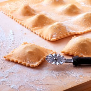 Homemade ravioli being cut apart.