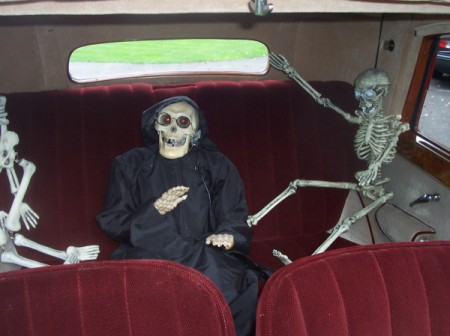 Halloween Skeleton in Back of Car with Red Upholstery