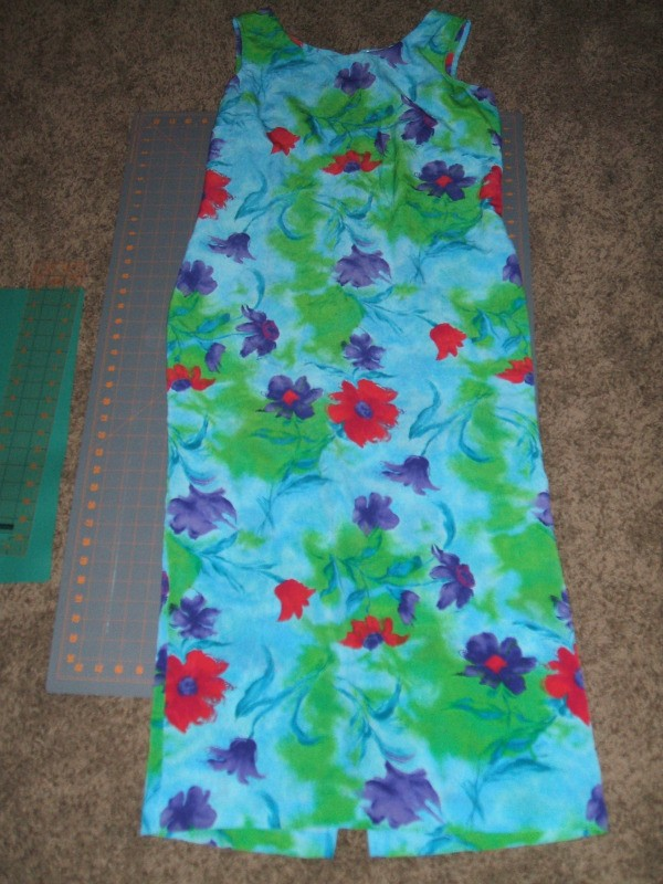 Long sleevelss aqua dress with green leaves, and pink and purple flower patterned all over.