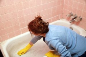 Woman Cleaning Bathtub