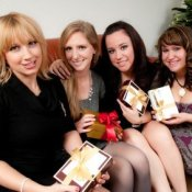 Four women exchanging gifts.