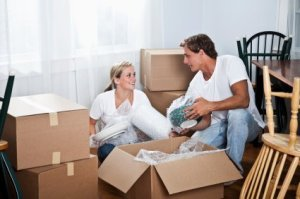 Young Couple Packing for A Move