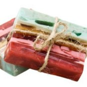 Striated homemade soap in reds, pinks, and blue.