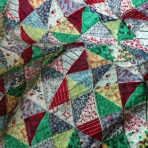 Image of vintage quilt composed of triangles.