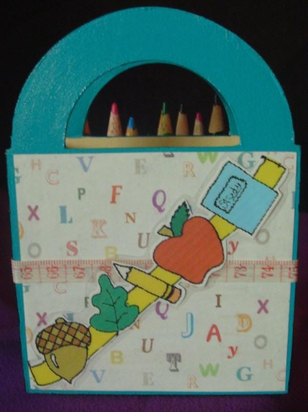 Back of colored pencil coverd wooden basket
