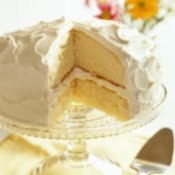 Vanilla frosting on a lemon layer cake.
