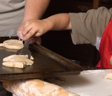 Photo of a kid making cookies.