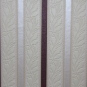 Striped wallpaper, cream, white, and dark with a strip of leaf motif.