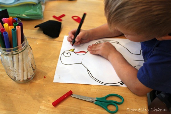 Young boy coloring turkey drawing in.