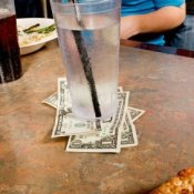Cash Tip Left UNder Water Glass at Pizza Restaurant