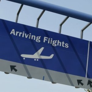 An arrival sign at an airport.