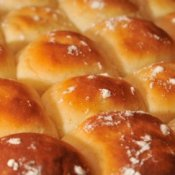 Freshly baked white dinner rolls.