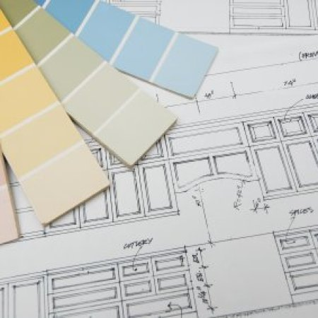 Paint chips on a kitchen blueprint.