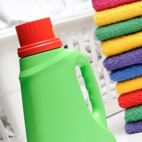 Uses for Laundry Detergent Caps, Laundry detergent bottle with red cap.