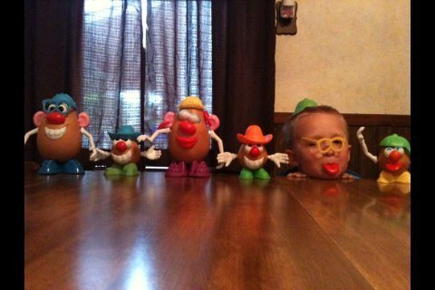 Boy Hiding Amongst Potato Heads