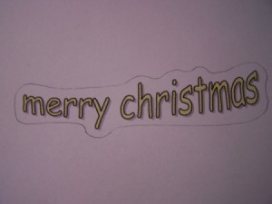 Sheet of paper with Merry Christmas printed