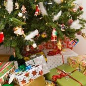 A decorated Christmas tree and wrapped presents.