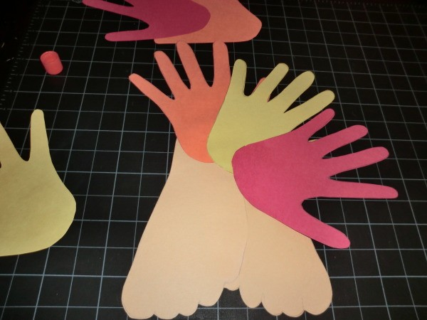 Adding handprints for tail.
