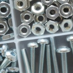 A tray of nuts and bolts.