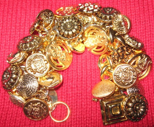 Gold button bracelet.