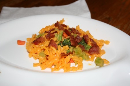 Mac and cheese with added carrots, broccoli, and bacon.