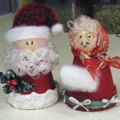 Clay pot Santa and Mrs. Claus.