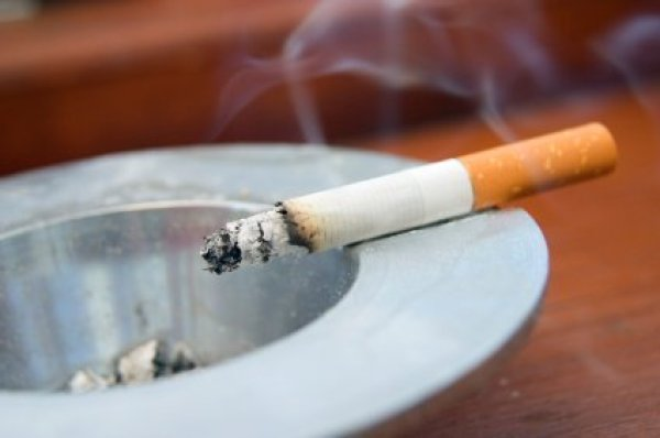 Cigarette Left Burning in Ashtray