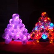 Photo of a lit Christmas tree made with baby food jars.