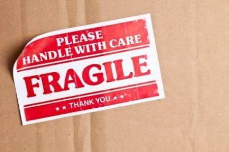 Fragile Label on Cardboard Shipping Box
