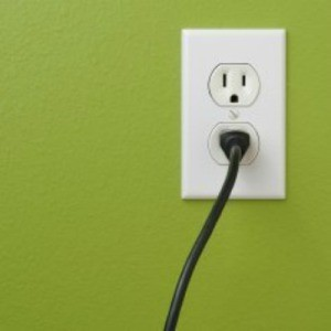 An electrical cord plugged into an outlet.