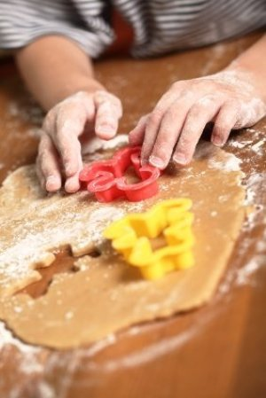 Plastic cookie cutters in use.