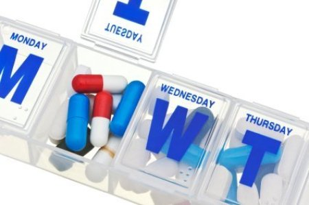 Closeup of Pills in Weekly Medication Organizer