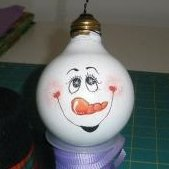 Uses for Light Bulbs (Incandescent), A recycled vanity lightbulb with a snowman face painted on it.