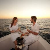 A couple eating on a boat.