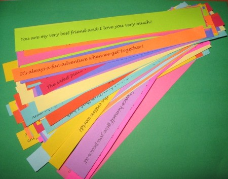 Multicolored cut memory papers cut and fanned out.