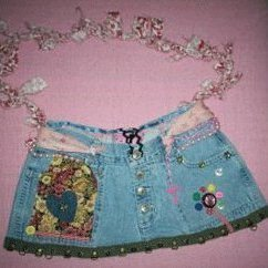 Jeans purse with ribbons and other decorations.