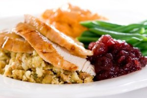 Thanksgiving Leftover Recipes. A Thanksgiving plate of turkey, stuffing, mashed potatoes, gravy, veggies and cranberry sauce.