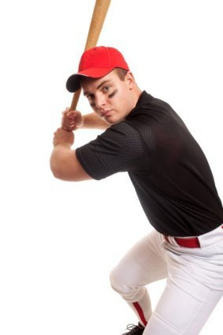 Removing Pine Tar from Baseball Pants. Baseball Player with Bat on White Background