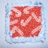 Potholder square red and white candy cane fabric with frayed edges