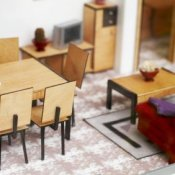 A small dining and living room in a doll house.