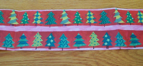 Strip of Christmas wrapping paper.