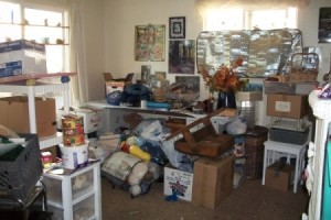 Stacks of craft items and boxes all over the place (before)