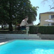 Invisible Car, Man Jumping in a Pool Posed Like he is Driving a Car
