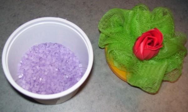 Purple Bath salts in plastic container
