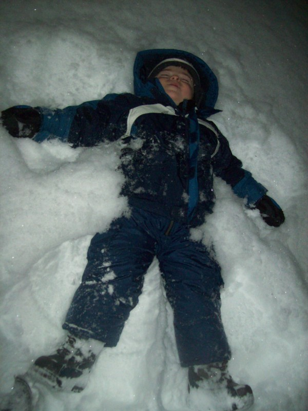 Child making his first snow angel.